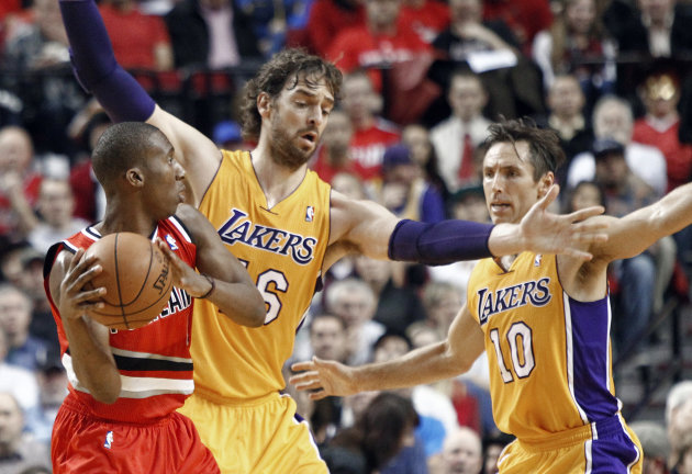 Portland Trail Blazers guard Nolan Smith, left, looks for help as Los Angeles Lakers' Pau Gasol, middle, and Steve Nash defend during the first quarter of an NBA basketball game in Portland, Ore., Wednesday, Oct. 31, 2012. (AP Photo/Don Ryan)