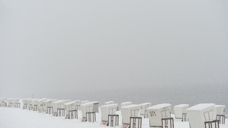 Snow-covered  beach chairs stand at the lido of  Strandbad Wannsee in Berlin, Germany,  Good Friday March 29, 2013. Bathing season at the lido traditionally starts on Good Friday.   (AP Photo/dpa, Rainer Jensen)