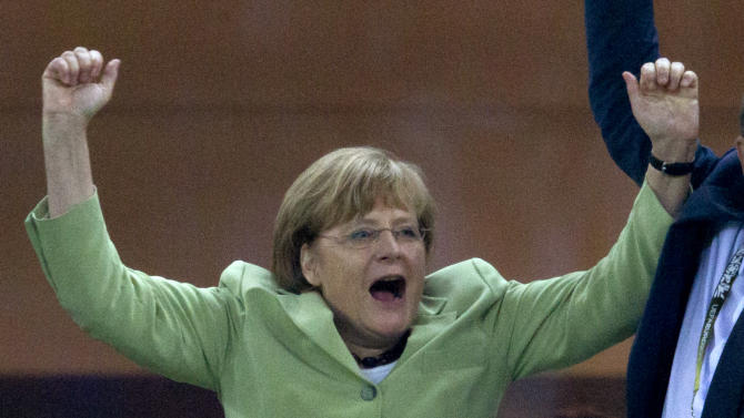 German Chancellor Angela Merkel celebrates during the Euro 2012 soccer championship quarterfinal match between Germany and Greece in Gdansk, Poland, Friday, June 22, 2012.(AP Photo/Gero Breloer)