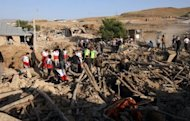 Iranian residents and rescue workers search for survivors near the town of Varzaqan on August 12. Two people were pulled out alive from the rubble on Tuesday three days after weekend quakes levelled villages in northwestern Iran, state media reported, and well after authorities halted rescue operations