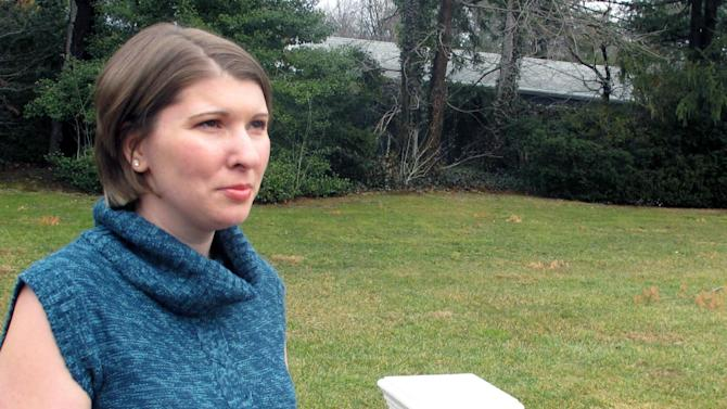 Katie Beers, whose kidnapping attracted nationwide headlines in 1992, poses for a photo on Monday, Jan. 14, 2013, in Old Westbury, N.Y. The 30-year-old mother of two has co-written a new book about her ordeal to mark the 20th anniversary of her release. She says she had been the victim of sexual abuse by a family acquaintance before being kept in a dungeon by another family friend for 17 days. (AP Photo/Frank Eltman)