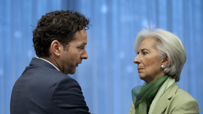 Dutch Finance Minister Jeroen Dijsselbloem, left, speaks with Managing Director of the International Monetary Fund Christine Lagarde during an extraordinary meeting of the eurogroup at EU headquarters in Brussels on Friday, March 15, 2013. European finance ministers are trying to complete a long-delayed bailout deal for Cyprus in a bid to keep the island nation from a bankruptcy that could rekindle the region's debt crisis. (AP Photo/Virginia Mayo)