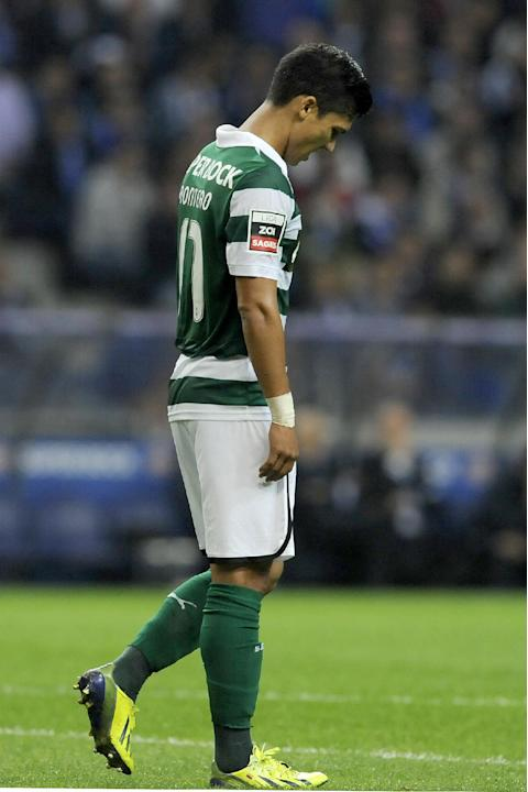 Sporting's Fredy Montero, from Colombia, reacts after missing a chance to score against  FC Porto in a Portuguese League soccer match at the Dragao stadium in Porto, Portugal, Sunday, Oct. 27, 2013. P