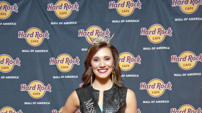 Miss Minnesota Savannah Cole walks the red carpet at the Grand Opening party for Hard Rock Cafe Mall of America on Wednesday, October 22, 2014, in Bloomington, Minn. (Photo by Craig Lassig/Invision for Hard Rock International/AP Images)