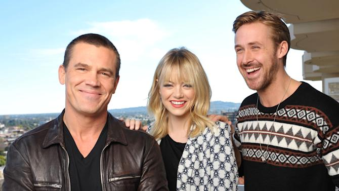 "FILE - In this Dec. 15, 2012 file photo, from left, actor Josh Brolin, actress Emma Stone, and actor Ryan Gosling from the cast of the film, ""Gangster Squad,"" pose for a portrait at the Four Seasons Hotel, in Beverly Hills, Calif. The film releases in theaters on Friday, Jan. 11, 2013.(Photo by John Shearer/Invision/AP, File)"