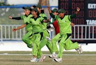Pakistan players invade the pitch to celebrate victory over Bangladesh in the women's limited-overs gold-medal match at the Asian Games in Guangzhou, China on November 19, 2010. Pakistan's women cricketers, in India for the World Cup, are staying in a stadium clubhouse instead of a hotel for security reasons, the International Cricket Council said