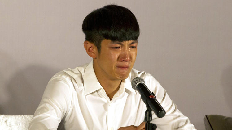 Kai Ko cries during a press conference held after his release from detention in Beijing Friday, Aug. 29, 2014. Ko, a Taiwanese actor arrested on drug charges along with the son of Hong Kong film star Jackie Chan, was released Friday after two weeks in detention, amid a broad anti-drug crackdown in China's capital that has ensnared several celebrities. (AP Photo/Peng Peng)