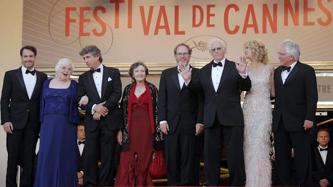 From left, actor Will Forte, actress June Squibb, director Alexander Payne, actor Angela McEwan, producer Albert Berger, actors Bruce Dern and Laura Dern and producer Ron Yerxa stand at the top of the stairs for the screening of Nebraska at the 66th international film festival, in Cannes, southern France, Thursday, May 23, 2013. (AP Photo/Francois Mori)