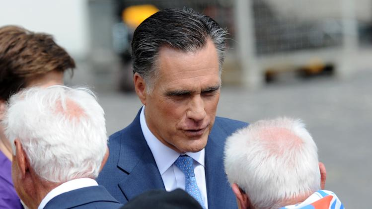 U.S. Republican presidential candidate, former Massachusetts Gov. Mitt Romney, facing camera, speaks with Polish WWII veterans and a survivor of a Nazi concentration camp after laying a wreath at the Warsaw 1944 Uprising monument in Warsaw, Poland, Tuesday, July 31, 2012. (AP Photo/Alik Keplicz)