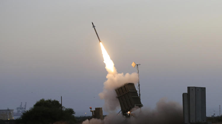 "An Iron Dome air defense system fires to intercept a rocket from Gaza Strip in the costal city of Ashkelon, Israel, Saturday, July 5, 2014. The Israeli military said its ""Iron Dome"" defense system intercepted the rockets that were aimed at Beersheba. The military also said at least 29 other rockets and mortars were fired from the Gaza Strip at Israel over the weekend. It said it had retaliated with airstrikes on militant sites in Gaza. (AP Photo/Tsafrir Abayov)"