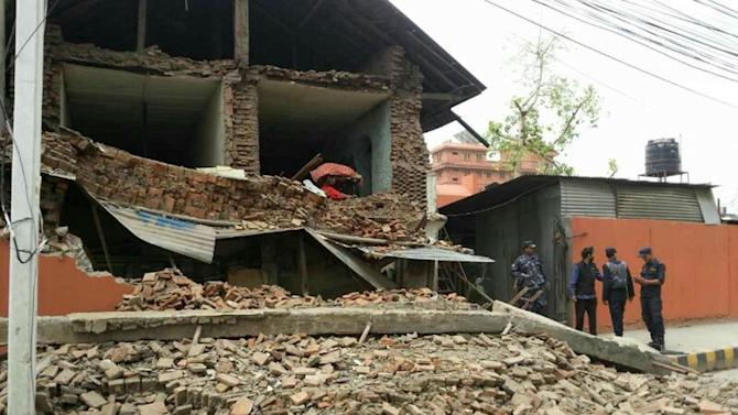 In this photo released by China's Xinhua News Agency, a collapsed building is seen in Nepal's capital Kathmandu Saturday, April 25, 2015. A strong earthquake shook Nepal's capital and the densely populated Kathmandu Valley before noon Saturday, causing extensive damage with toppled walls and collapsed buildings, officials said. (Zhou Shengping/Xinhua via AP) NO SALES