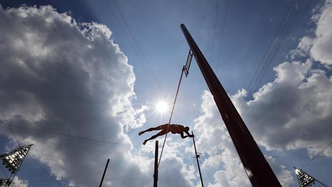 United States' Ashton Eaton clears the bar in the decathlon pole vault during the athletics in the Olympic Stadium at the 2012 Summer Olympics, London, Thursday, Aug. 9, 2012. (AP Photo/David J. Phillip )