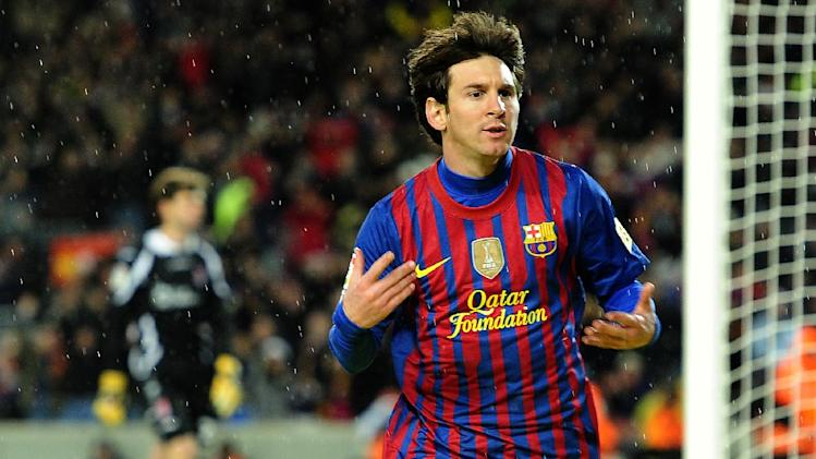 FC Barcelona's Lionel Messi, from Argentina, reacts after scoring against Granada during a Spanish La Liga soccer match at the Camp Nou stadium in Barcelona, Spain, Tuesday, March 20, 2012. (AP Photo/Manu Fernandez)