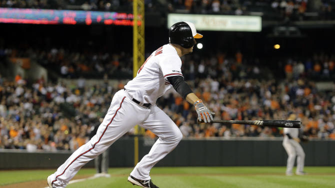 Baltimore Orioles' Kelly Johnson watches his double in the ninth inning of a baseball game against the New York Yankees, Sunday, Sept. 14, 2014, in Baltimore. Steve Pearce scored the winning run on the play, and Baltimore won 3-2. (AP Photo/Patrick Semansky)