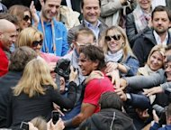 Spain's Rafael Nadal celebrates with his family after winning his seventh French Open final in Paris on June 11. Nadal clinched the record title on Monday, defeating world number one Novak Djokovic 6-4, 6-3, 2-6, 7-5 and shattering the Serb's dream of Grand Slam history