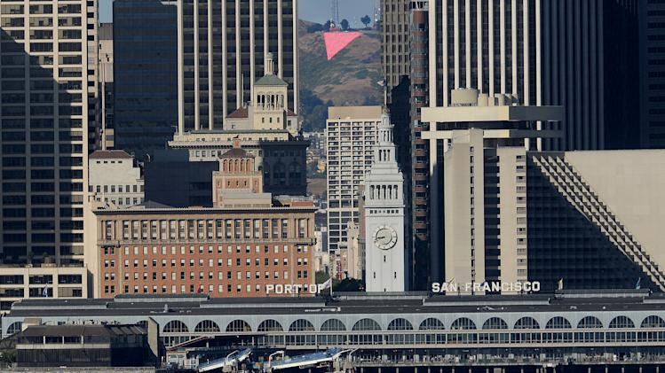 A pink triangle blankets a hilltop in San Francisco to mark the city's 42nd annual gay pride celebration on Sunday, June 24, 2012. San Francisco's 42nd annual Gay Pride Celebration kicks into high gear Sunday when the streets of downtown are expected to be jammed with revelers for the annual parade. Organizers say more than 200 floats, vehicles and groups of marchers will take part in the parade. (AP Photo/Noah Berger)