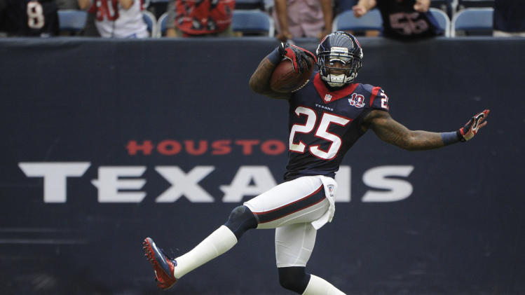Houston Texans cornerback Kareem Jackson dances into the end zone for a touchdown after an interception during the fourth quarter of an NFL football game against the Tennessee Titans, Sunday, Sept. 30, 2012, in Houston. The Texans won 38-14. (AP Photo/Dave Einsel)