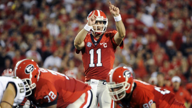FILE - In this Sept. 22, 2012, fil ephoto, Georgia quarterback Aaron Murray (11) signals at the line of scrimmage  during the second quarter of an NCAA college football game against Vanderbilt in Athens, Ga. Georgia's offense has been largely unstoppable, averaging nearly 50 points over its first five games. But now they face their toughest challenge yet, taking on No. 6 South Carolina and nemesis Steve Spurrier on Saturday. (AP Photo/John Amis, File)