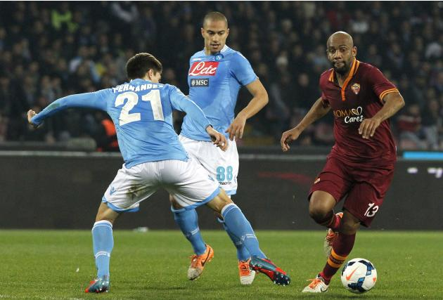 Napoli's Fernandez challenges Maicon of AS Roma during their Serie A soccer match at San Paolo stadium in Naples