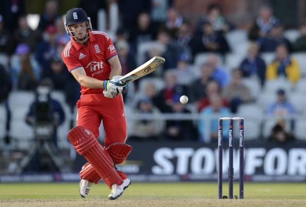 England's Buttler misses the ball during the second ODI against Australia in Manchester