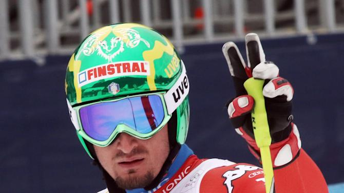 Italy's Dominik Paris stands in the finish area during a men's World Cup downhill training session in Garmish Partenkirchen, Germany, Friday, Feb. 27, 2015. (AP Photo/Armando Trovati)