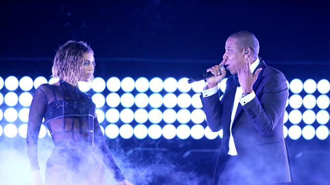 """FILE - This Jan. 26, 2014 file photo shows Beyonce, left, and Jay Z performing """"Drunk in Love"""" at the 56th annual Grammy Awards in Los Angeles. Beyoncé and Jay Z lead in nominations for the BET Awards. The network announced Wednesday that the performers are both nominated for five awards, along with Drake. Pharrell and rising performer August Alsina have four nominations. The BET Awards will air live on June 29 from the Nokia Theatre L.A. Live. (Photo by Matt Sayles/Invision/AP, File)"""