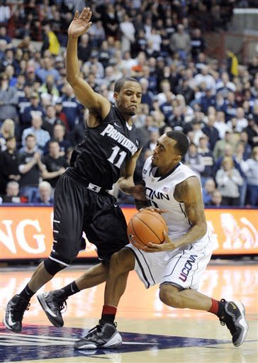 Boatright leads UConn over Providence 63-59 in OT