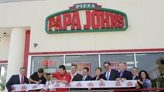 John Schnatter, red shirt, Founder, Chairman and CEO of Papa John's International, Inc., cuts the ribbon for the opening of his 4000th restaurant on Friday Sept. 14, 2012, in New Hyde Park, N.Y. l-r: Nassau County Executive Edward Mangano (red tie), Executive Vice President of Papa John's Anthony Thompson, New Hyde Park franchise owner Peter Mehta, John Schnatter, Town of North Hempstead Supervisor Jon Kaimen, NY Assemblyman Ed Ra, Town of North Hempstead Town Clerk Leslie Gross, President of the New Hyde Park Chamber of Commerce Mark Laytin, Nassau County Legislator Richard Nicolello, Secretary of the New Hyde Park Chamber of Commerce Jerry Badassaro and First Vice President of the New Hyde Park Chamber of Commerce Jeannette Frisina. (Photo by Kathy Kmonicek/Invision for Papa John's/AP Images)