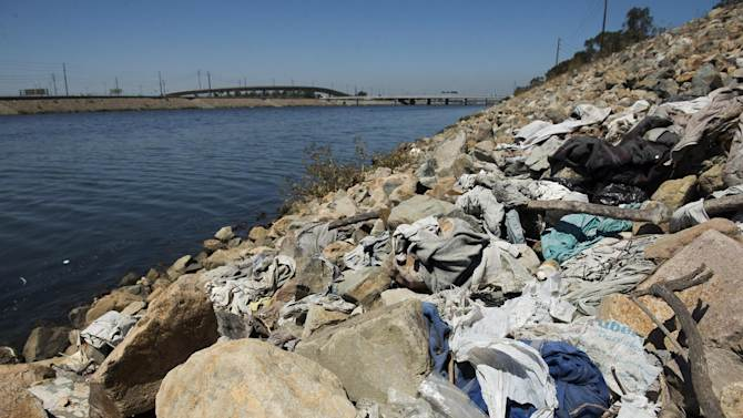 FILE-This Tuesday, Sept. 2, 2014 file photo shows a large pile of washed-up trash, including old plastic bags, sits alongside the Los Angeles River in Long Beach, Calif. On Tuesday, Sept. 30, 2014 Gov. Jerry Brown signed legislation on  imposing the nation's first statewide ban on single-use plastic bags. (AP Photo/The Orange County Register, Josh Morgan,File)   MAGS OUT; LOS ANGELES TIMES OUT
