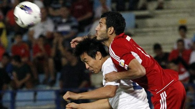 South Korea's Kim Chi-Woo (L) fights for the ball with Lebanon's Mohamad Tahan (Reuters)