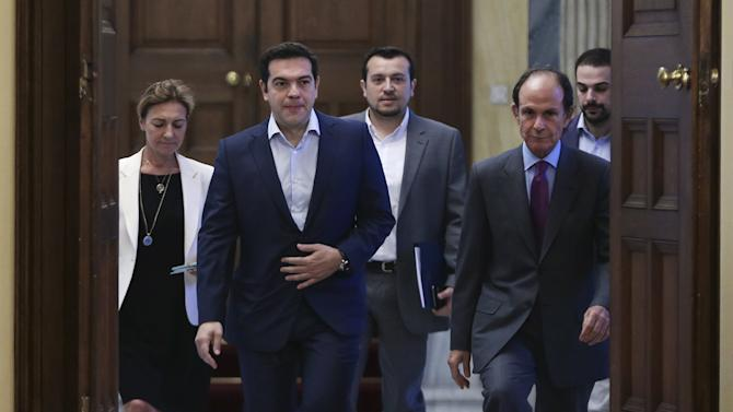 Greek PM Tsipras arrives for a meeting of political party leaders at the Presidential Palace in Athens