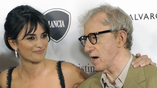 "FILE - U.S. film director Woody Allen, right, and actress Penelope Cruz, pose for photographers before the screening of their film 'Vicky Cristina Barcelona' in Barcelona, Spain, in this file photo dated Saturday, Sept. 20, 2008.  In a statement released Sunday Sept. 9, 2012 Oscar-winning actress Cruz denied saying she would create hundreds of jobs in Spain by making at least two films a year there and slammed an Italian newspaper for allegedly manipulating her words, saying the financial crisis engulfing Spain was too serious an issue ""to allow my words to be misinterpreted or manipulated for the sake of manufacturing frivolous headlines."" (AP Photo/Manu Fernandez, File)"