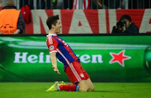 Robert Lewandowski celebrates scoring Bayern Munich's fifth goal during the Champions League sec