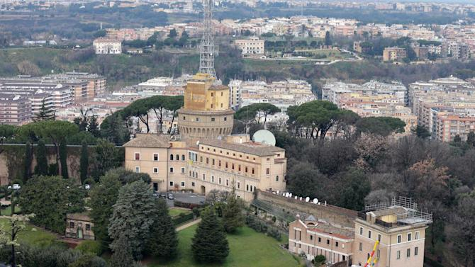 A view of the Mater Ecclesiae Monastery, right, next to the Tower of San Giovanni, inside the Vatican State where Pope Benedict XVI is expected to live after he resigns, on Tuesday, Feb. 12, 2013. For months, construction crews have been renovating a four-story building attached to a monastery on the northern edge of the Vatican gardens where nuns would live for a few years at a time in cloister. Only a handful of Vatican officials knew it would one day be Pope Benedict XVI's retirement home. On Tuesday, construction materials littered the front lawn of the house and plastic tubing snaked down from the top floor to a dump truck as the restoration deadline became ever more critical following Benedict's stunning announcement that he would resign Feb. 28 and live his remaining days in prayer. (AP Photo/Alessandra Tarantino)