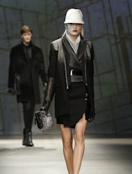 Models walk the runway during the presentation of the Kenneth Cole Fall 2013 fashion collection during Fashion Week in New York, Thursday, Feb. 7, 2013. (AP Photo/Kathy Willens)