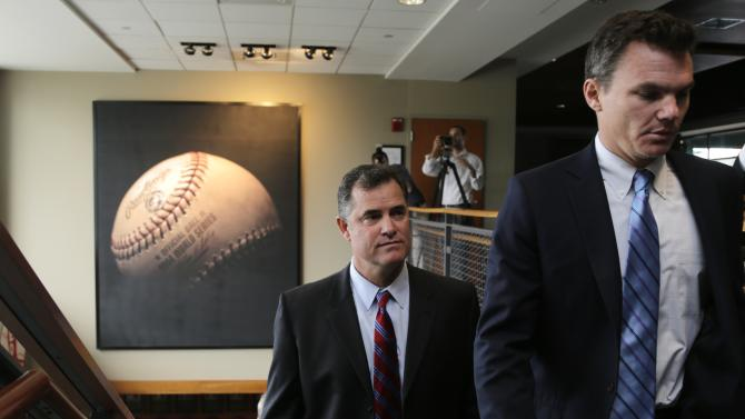 Boston Red Sox manager John Farrell follows general manager Ben Cherrington as they arrive for a news conference at Fenway Park in Boston, Tuesday, Oct. 23, 2012.  Farrell becomes the 46th manager in the club's 112-year history. (AP Photo/Charles Krupa)