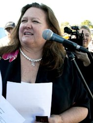 The world&#39;s richest woman Gina Rinehart, pictured in 2010, has boosted her stake in ailing Australian media giant Fairfax to 18.67 percent as she bids to win a board seat, it was revealed Monday