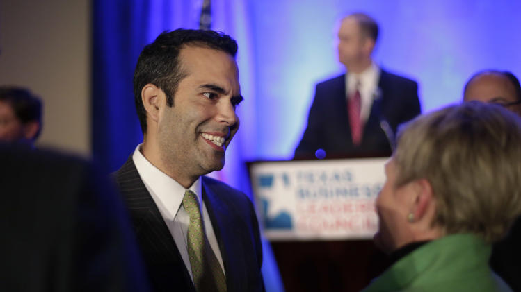 George P. Bush, left, talks to guests prior to making the opening statements at the Texas Business Leadership Council, Tuesday, Feb. 26, 2013, in Austin, Texas. (AP Photo/Eric Gay)