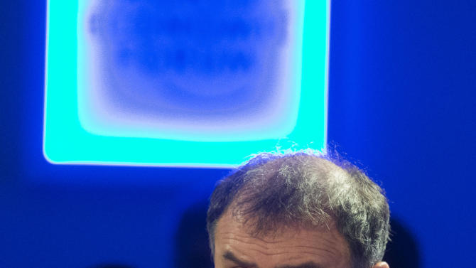 Professor of Economy at the New York University, Noureil Roubini, gestures as he speaks during a session on Pundits, Professors and their Predictions, of the 43rd Annual Meeting of the World Economic Forum, WEF, in Davos, Switzerland, Saturday, Jan. 26, 2013. (AP Photo/Michel Euler)