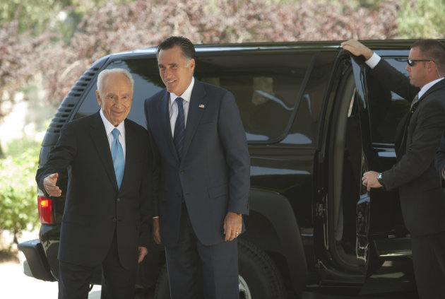 Israel's President Shimon Peres, left, and US Republican presidential candidate Mitt Romney walk during a meeting at the President's residence in Jerusalem, Sunday, July 29, 2012. Romney would back an Israeli military strike against Iran aimed at preventing Tehran from obtaining nuclear capability, a top foreign policy adviser said early Sunday, outlining the aggressive posture the Republican presidential candidate will take toward Iran in a speech in Israel later in the day. (AP Photo/Sebastian Scheiner)