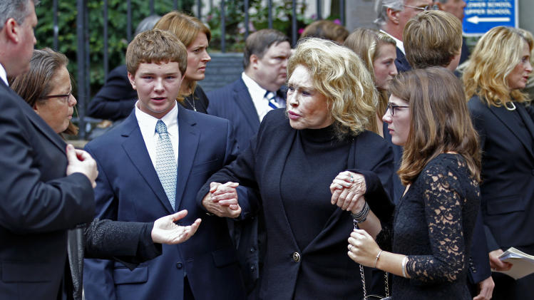Grace and Max Kennedy hold hands with Joan Kennedy as the leave Holy Trinity Church in Washington Wednesday, Sept. 21,  2011, after funeral services for Kara Kennedy. Kara Kennedy died Friday after a workout at a Washington health club. (AP Photo/Jose Luis Magana)