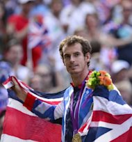 Great Britain's Andy Murray poses with his gold medal at the end of the men's singles tennis tournament of the London 2012 Olympic Games, at the All England Tennis Club in Wimbledon, southwest London,