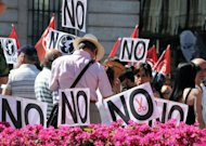 &lt;p&gt;Government employees take part in a demonstration organized by unions in Madrid on July 13, against the government&#39;s welfare cuts.&lt;/p&gt;