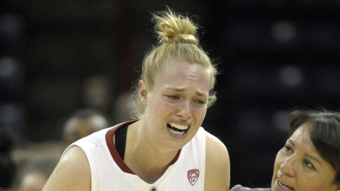 Stanford's Taylor Greenfield (4) leaves the court with a hand injury during the first half of Stanford's game against Georgia in a regional semifinal in the NCAA women's college basketball tournament, Saturday, March 30, 2013, in Spokane, Wash. (AP Photo/Jed Conklin)