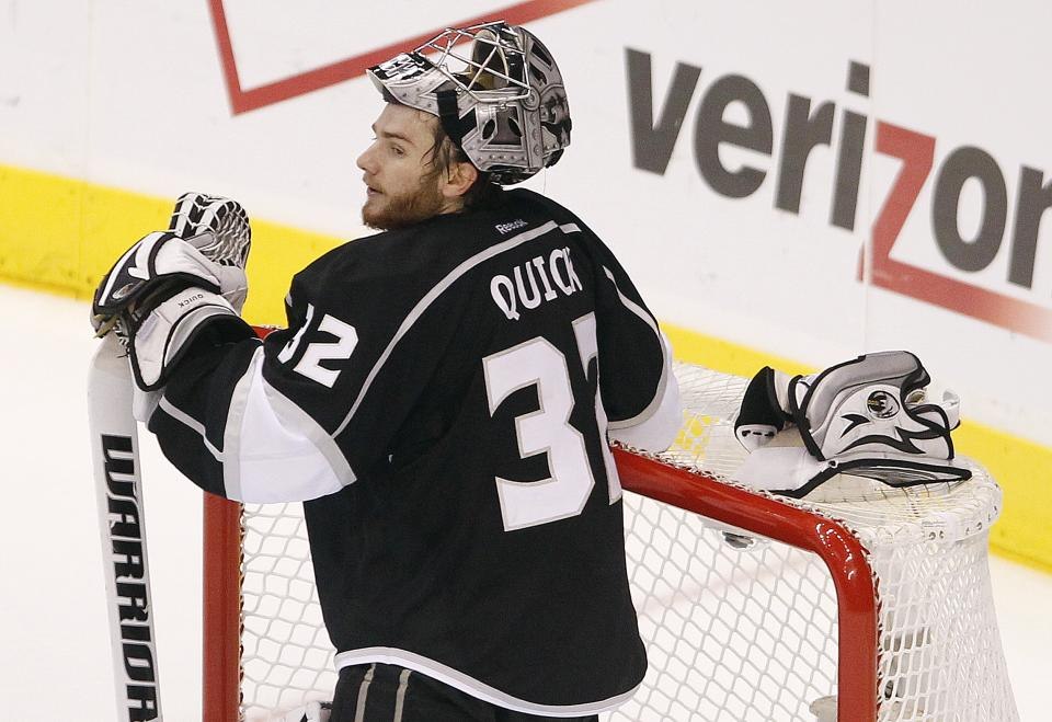 Los Angeles Kings goalie Jonathan Quick (32) reacts after giving up a goal to the New Jersey Devils in the third period during Game 4 of the NHL hockey Stanley Cup finals, Wednesday, June 6, 2012, in Los Angeles. The Kings lost the game 3-1. (AP Photo/Jae C. Hong)
