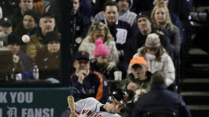 San Francisco Giants first baseman Brandon Belt hits an RBI triple during the second inning of Game 4 of baseball's World Series against the Detroit Tigers Sunday, Oct. 28, 2012, in Detroit. (AP Photo/Charlie Riedel)
