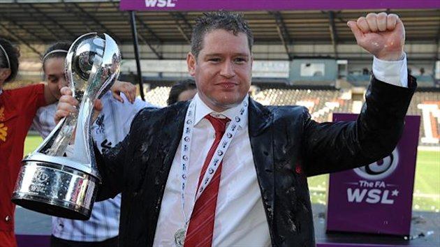 Liverpool's manager Matt Beard with the FA Women's Super League Trophy