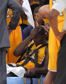 Lakers forward Julius Randle is removed on a stretcher  Tuesday night. (AP Photo)
