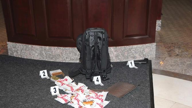 This handout photo provided by the US Attorney's office shows a backpack, gun, ammunition and 15 Chick-fil-A sandwiches at the scene where Floyd Corkins II shot a security guard at the Family Research Council in Washington last year.  Prosecutors say a Virginia man who planned a mass killing at the Washington headquarters of a conservative Christian lobbying group should spend 45 years in prison for his plot.  Corkins pleaded guilty to three charges in February: interstate transportation of a firearm, assault with intent to kill while armed and committing an act of terrorism while armed. The first charge carries a maximum of 10 years in prison and the two other charges carry a maximum 30 years in prison. Sentencing is set for April 29.   (AP Photo/US Attorney's office)
