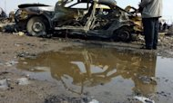 A destroyed car lies at the scene of an explosion at the bird market in the Baghdad neighbourhood of Kadhimiyah, on February 8, 2013. A spate of car bombs in Shiite areas of Iraq, including two blasts minutes apart at a popular bird market, killed at least 33 people, the latest spike in violence amid a simmering political crisis